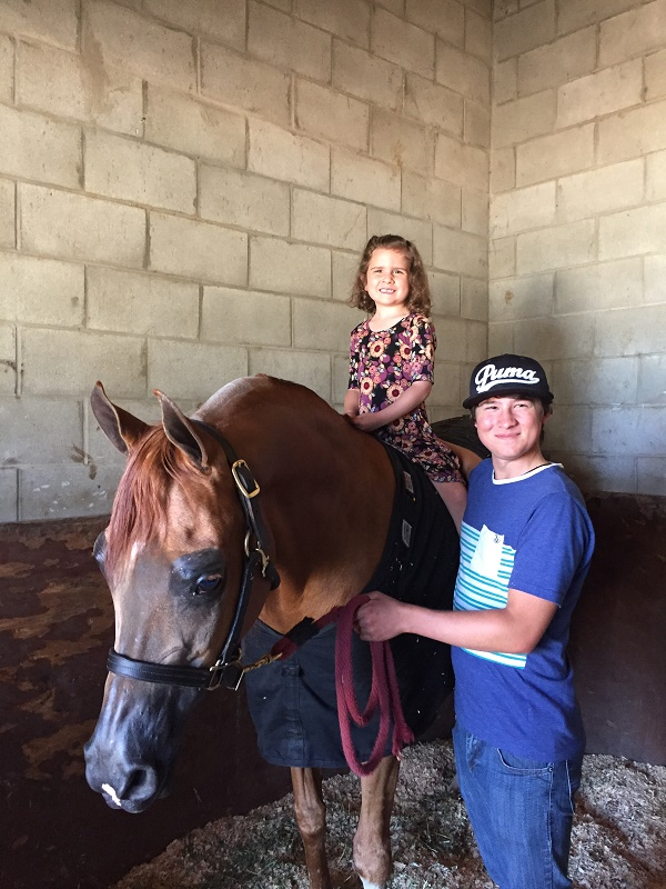 Paediatric cancer patient Layla with Ryan and her Warrior horse,  US National Champion LD Pistal.