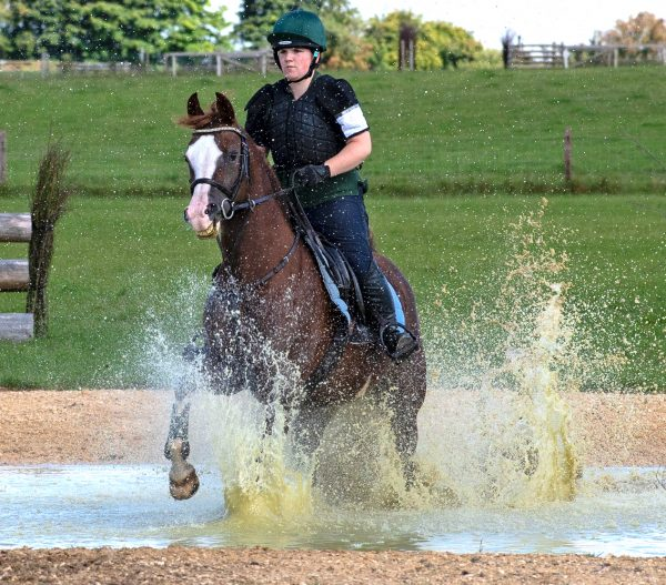 Penny splashing through the water under the watchful eye of Olympian Jonty Evans (c) Photography by Shelley