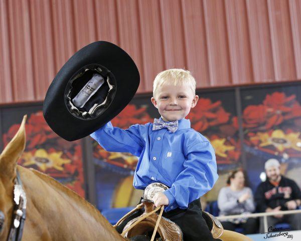 child on western horse